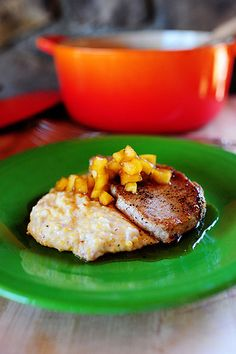 Pork Chops with Apples & Creamy Bacon Cheese Grits // Pioneer Woman (Food Network Link: http://www.foodnetwork.com/recipes/ree-drummond/pork-chops-with-applesauce-and-grits.html)