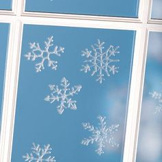 DIY Glittery snowflake window clings. You can do this for any festivity/holiday or just for fun!