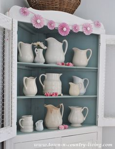 White ironstone in a farmhouse hutch