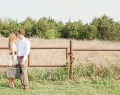 Love this shot! Engagement session by a field