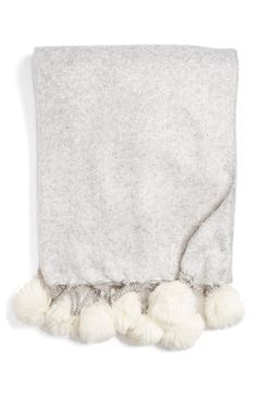 Free shipping and returns on Nordstrom at Home Faux Fur Throw at Nordstrom.com. A lavish faux-fur throw blanket finished with decadent pompoms makes a refined yet cozy addition to your living room or bedroom décor.