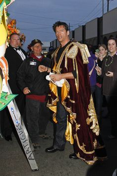 It's Krewe of Orpheus co-founder and New Orleans-native Harry Connick Jr. preparing to board his float.