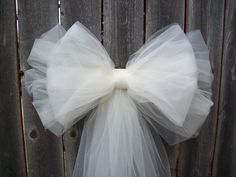 Tulle Pew Bow Tulle Wedding Church Pew Decor by OneFunDay on Etsy Church Aisle Decorations, Pew Decorations, Quinceanera Decorations, Quinceanera Ideas, Tulle Wedding Decorations, Wedding Aisles, Wedding Church Aisle, Church Pews, Trendy Wedding