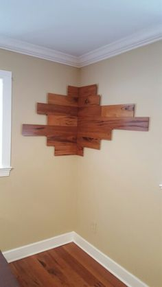 Left over hardwood flooring pieces becomes decorative wall art!