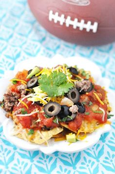 Individual Nachos with avocado, olives, and salsa. (We promise not to tell if you use ground beef or turkey instead of bison.)