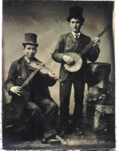 19th century early minstrel show musicians with banjo and fiddle.