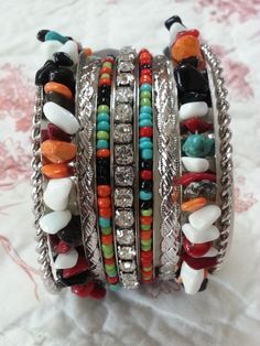 Chunky natural stone bangles set. Turquoise, coral, onyx and more. Go to Red River Cowgirl Clothing Company on facebook.