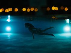 Picture of a girl swimming underwater