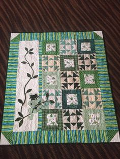 This one of a kind quilt began with the green star blocks after I purchased them at my quilt guilds Country Store. I combined them with my own