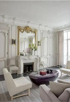 Love the all-white living room with glam gold accents.