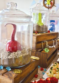 Neverland Pirate Party: ship-in-a-bottle-inspired centerpieces...hook, sword, pirate ship...spray-painted to match theme