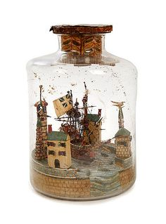 An unusual mid 19th century French naval Diorama in bottle Consisting of a two-deck English Man-Of-War sailing into a harbour with stylised buildings and porpoises.