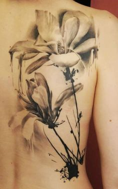 Black and white watercolor tattoo.