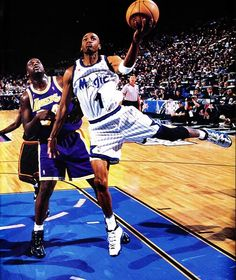 Penny Hardaway drives over his former teammate Shaquille O'neal