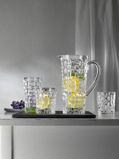 The Dancing Stars Bossa Nova Crystal Barware Collection by Nachtmann consists of stylish, economical crystal bar glasses and a pitcher. The bold, faceted braid-like pattern that completely decorates the items is as delightful to view as to hold. Star Wars, Old Fashioned Glass, Highball Glass, Glass Pitchers, Mirror Art, Basket Weaving, Pottery Barn, Serveware