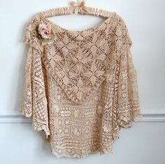 poncho of lace.