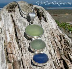 Smooth Pacific tumbled sea glass ovals in lime green, seafoam green, and soft blue are set in sterling silver and hang from a handsome slide bail.