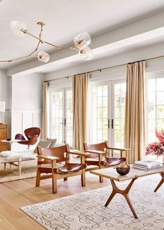 gorgeous french doors and tons of light in this warm open living room   pilar guzman house tour via coco kelley
