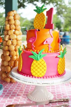 Vivid cake at a tropical first birthday party! See more party ideas at CatchMyParty.com!
