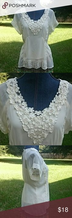 Off white cream crochet sheer top boho This is a gorgeous summer top. Sheer material trimmed with gorgeous crochet and a matching camisole underneath. Little bit of elastic in front and back to enhance waist. Polyester material is sheer. Adiva Tops