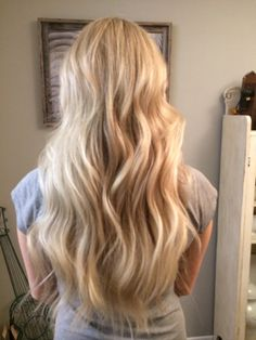 Mermaid hair. I did a full highlight and toned her a bright blonde. Added some beach waves!