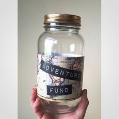 Map repurposed for travel savings jar