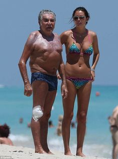 Roberto Cavalli, and his much younger girlfriend frolic on beach He has built his empire on collections featuring exotic prints, often leopard print. Roberto Cavalli, Bikinis, Swimsuits, Swimwear, Relationship Science, Italian Fashion Designers, Gymnastics Girls, Beautiful Girl Image, Beautiful Women