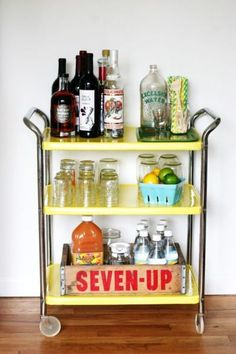 How to Stock a Fabulous Bar Cart. This is a great way to use the old soda crates I see so many of at the Flea Market!