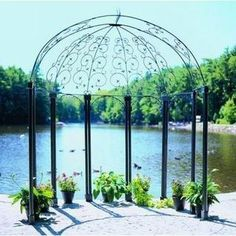 Achla Designs Euphony x Wrought Iron Pavilion Gazebo, Black. Reminiscent of the great cathedrals in Italy, theAchla Euphony x Wrought Iron Pavilion Gazebo brings elegance and style to your outdoor oasis. Diy Pergola, Pergola Swing, Metal Pergola, Pergola With Roof, Wooden Pergola, Backyard Pergola, Pergola Shade, Pergola Ideas, Garden Gazebo
