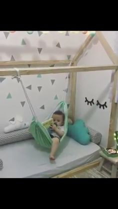 Reading hammock on toddler floor bed. Credit: Only Pho0oto Babys