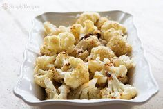 Roasted Cauliflower ~ Oven-roasted cauliflower florets, with garlic, lemon, olive oil, and Parmesan cheese. So good! ~ SimplyRecipes.com