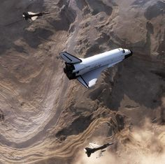 Two F-16s escorting the Space Shuttle.