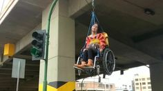 People who use wheelchairs protested against the Govt. in Bolivia by suspending themselves in their wheelchairs from a bridge, demanding a raise in subsidies.