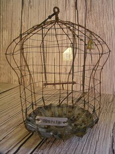 Another great one - tart tin bird cage.  (I'm thinking could make one for a garden accent as well)