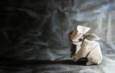 Geometry and expressiveness without too much shaping? Definitely a good thing.   Origami Rabbit designed by Yoo Tae Jong and  folded by me from a single square of lokta paper 30x30cm