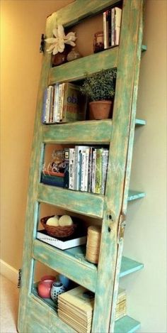 Old door turned into a shelf – this has got to be the coolest repurposed door I've ever seen!