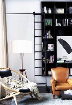 Corner vignette of Johnny Buckland's ultra-cool Manhattan pad, with modern built-in shelves and leather armchair.