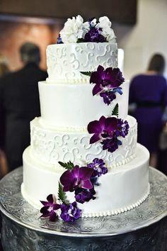White and purple wedding cake with cascading purple flowers - Copyright: Bello Romance Photography #floralweddingcakes