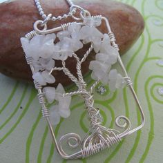 https://flic.kr/p/4RrnCk | IMG_0229 | Rainbow Moonstone tree of life pendant Available at the Bead Cafe