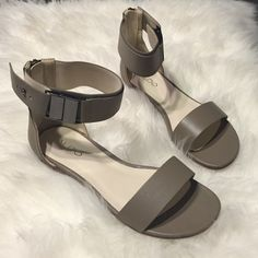 Aldo Taupe Sandals - Size 6.5 Brand-new and never worn Aldo taupe sandals in size 6.5. Full zipper in back of sandal for secure closure. Perfect to match every outfit! ALDO Shoes Sandals
