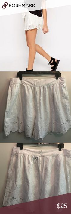 """Asos white eyelet Lace shorts NWOT Asos white eyelet Lace shorts. Zips up in back, not drawstring. 100% lined cotton. Cool & comfy for spring summer activities. Sz 14 36"""" waist, 6"""" inseam. NWOT never worn. Check my closet for matching or other similar items. No trades. ASOS Shorts"""