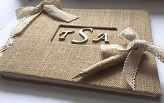 A beautiful rustic handmade guestbook created from scratch, is the perfect size to display on tables or pass around at an engagement party, bridal shower or wedding! The book can be used to display photographs of the couple or bride-to-be and gives guests the opportunity to write advice and well wishes. The book is covered in Natural burlap fabric with a champagne lace ribbon to match your color scheme. It is a 5-hole binder designed in a corset pattern. Personalized in wood, the couples…