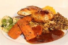 Succulent Roast Chicken with real chicken gravy, tasteful stuffing, fondant roast potato, and vegetables.