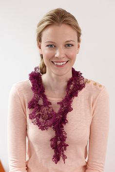The LB Collection Wool Stainless Steel yarn used in this crocheted scarf helps make it look like a work of art! Make yours with 2 cones of yarn (pictured in cerise) and a size G-6 (4mm) crochet hook.