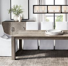 RH's Herringbone Rectangular Dining Table:Our collection's timeless…