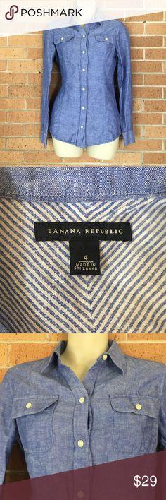 "Banana Republic Linen Blend Chambray Shirt 4 Banana Republic Linen Shirt  Size 4 Convertible Sleeves  Length 27"" Armpit to armpit 18"" 65% Linen 35% Cotton  REASONABLE OFFERS WILL BE CONSIDERED Banana Republic Tops Button Down Shirts"