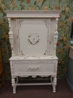 $335 - Rustic shabby antique china closet with 1 drawer and single door cabinet above- painted creamy white and heavily distressed. ***** In Booth H13 at Main Street Antique Mall 7260 E Main St (east of Power RD on MAIN STREET) Mesa Az 85207 **** Open 7 days a week 10:00AM-5:30PM **** Call for more information 480 924 1122 **** We Accept cash, debit, VISA, Mastercard, Discover or American Express