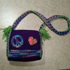 Crocheted Peace & Love lined Purse Handmade Crocheted Peace & Love purse. Lined 9th the inside. No closure. Cute and fun to wear. Great for the hippy in your life. Ravens Hollow  Bags Shoulder Bags