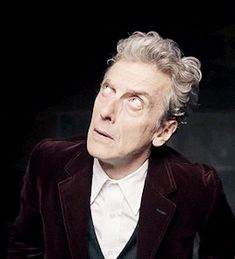 """Wonderful blue eyesWonderful silver hairWonderful smug movementsWonderful Tongue actionWonderful """"Be Happy"""" SmileWonderful in the rainWonderful when sadWonderful on the phoneI could go on and on but I. Doctor Love, All Doctor Who, 12th Doctor, Twelfth Doctor, Peter Capaldi Doctor Who, Crooked Man, Blake Lively Style, John Barrowman, British Men"""