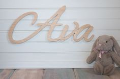 wooden name sign Baby Name Plaque // spray paint it gold!